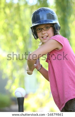 Young girl ready to hit t ball - stock photo