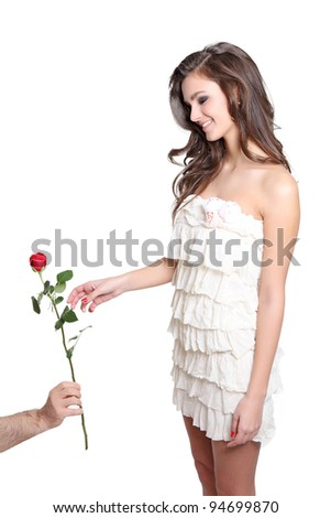 Young girl receiving a rose from a boy - stock photo