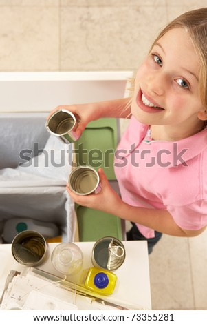 Young Girl Recyling Waste At Home - stock photo
