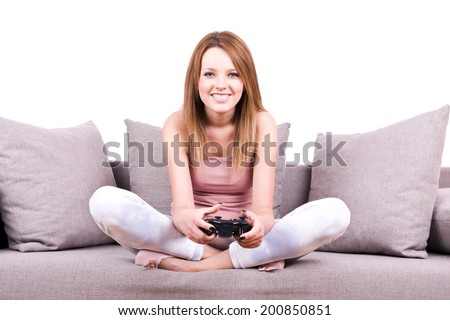young girl relaxing and playing video games