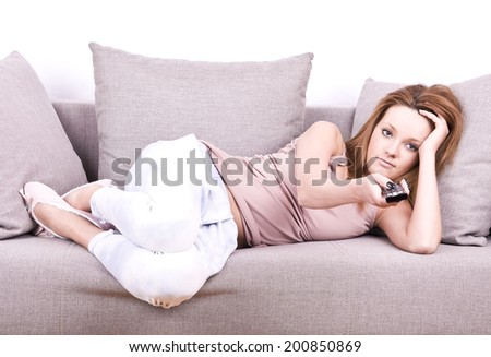 young girl relaxing and watching TV - stock photo