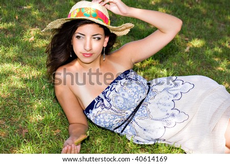 young girl relaxing at the park - stock photo