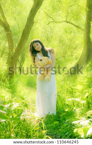 young girl relaxing in bright spring greens - stock photo