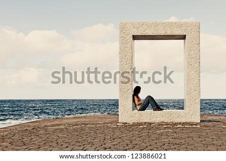 Young Girl Relaxing in Garachico Town, Tenerife, Spain - stock photo