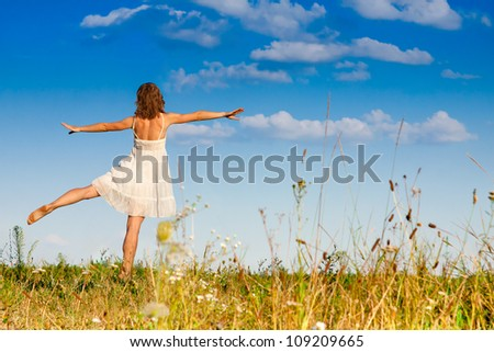 Young girl relaxing on a green field - stock photo