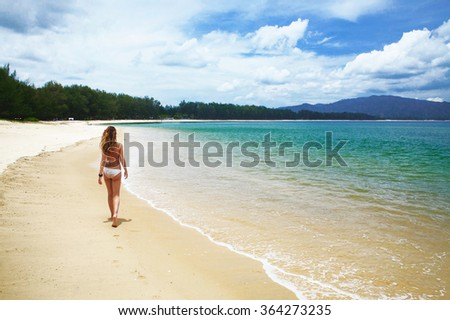 Young girl relaxing on a tropical beach