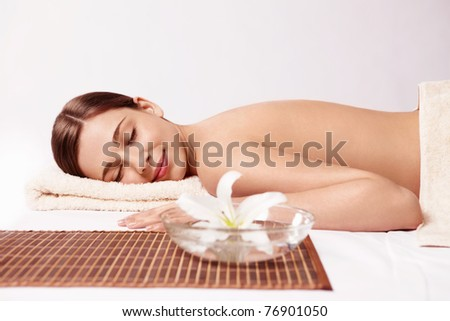 Young girl relaxing on a white background - stock photo