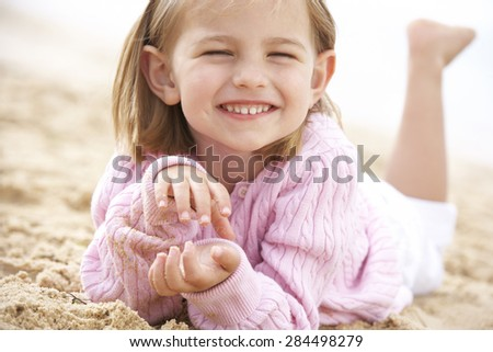 Young Girl Relaxing On Beach - stock photo