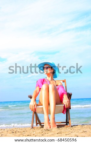 young girl relaxing on beach  in Greece