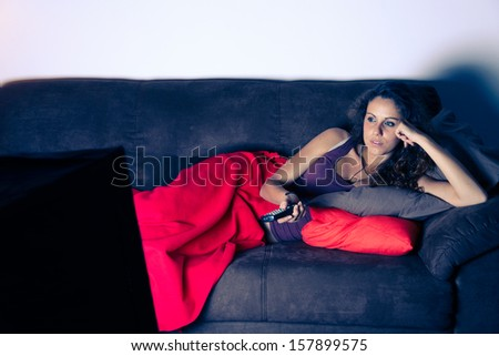 Young girl relaxing on sofa - stock photo