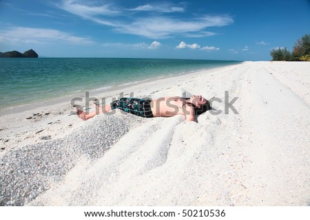 Young  girl relaxing on the beach.