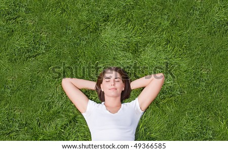 Young Girl Resting in the Grass - stock photo