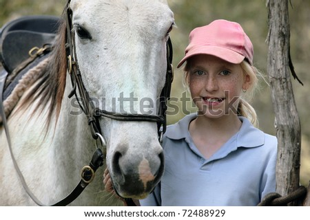 young girl rider with a white horse - stock photo