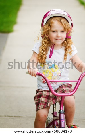young girl riding a bike - stock photo