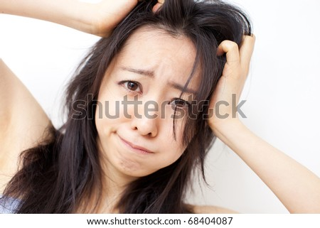 young girl scratching her hair