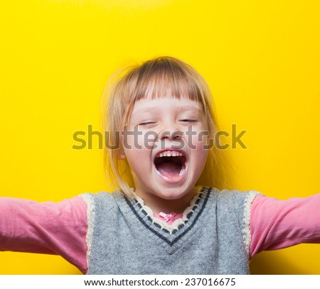 Young girl screaming with arms out, feet spread - stock photo