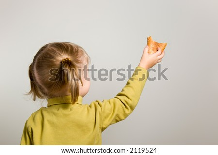 young girl share with bread - stock photo