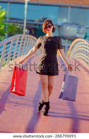 Young girl shopping the mall late in the day
