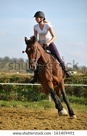 young girl show jumping
