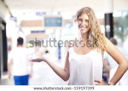 young girl showing gesture in a shopping center - stock photo