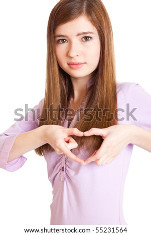 "Young girl showing ""heart"" with her fingers. Isolated on white background - stock photo"