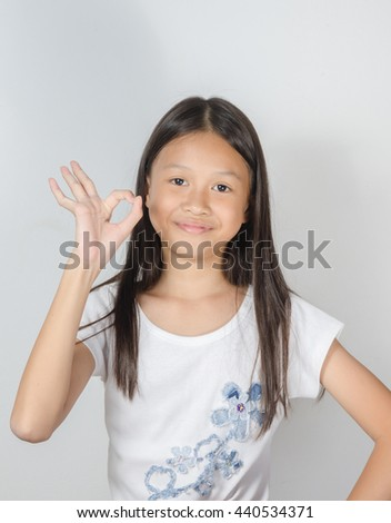 Young girl showing her hand gesture ok - stock photo