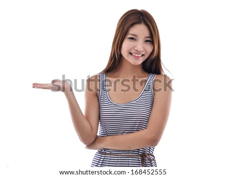 Young girl showing something on the palm of her hand - stock photo