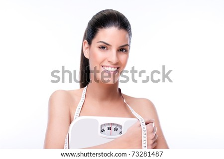 Young girl shows her ideal weight - stock photo