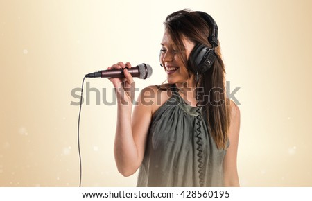 Young girl singing with microphone