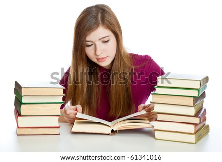 Young girl sitting  and reading book. Isolated on white background - stock photo