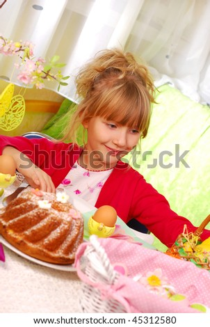young girl sitting by easter table