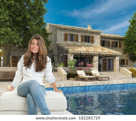 Young girl sitting by the pool in a beautiful house - stock photo