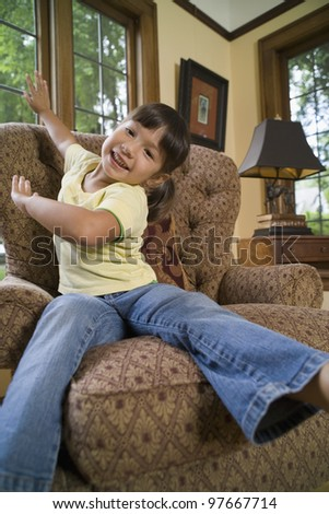 Young girl sitting in chair