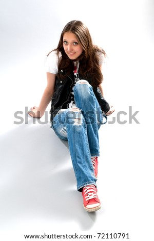young girl sitting on a floor - stock photo