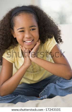 Young Girl Sitting On A Sofa At Home - stock photo