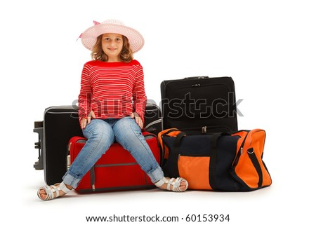Young girl sitting on luggage and waiting. Isolated on white