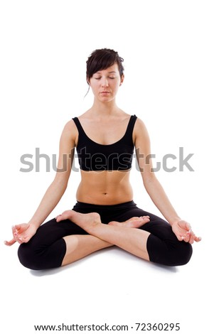 Young girl sitting on the white background doing yoga - stock photo