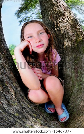 Young girl sitting on trunks of huge oak trees