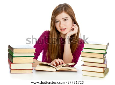 Young girl sitting ?t th? d?sk and reading book. Isolated on white background