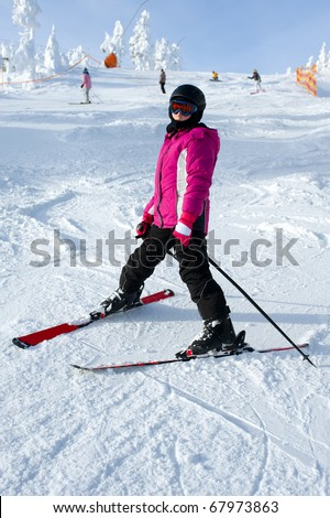 Young girl skiing - stock photo