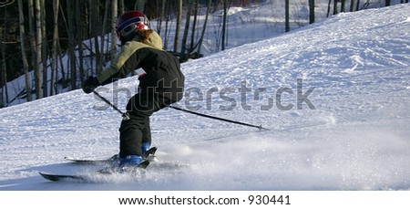 Young Girl Skiing Downhill - stock photo