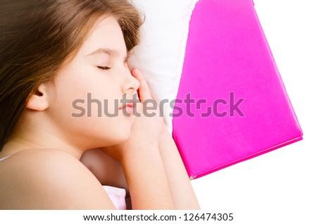 young girl sleep with pink book - stock photo