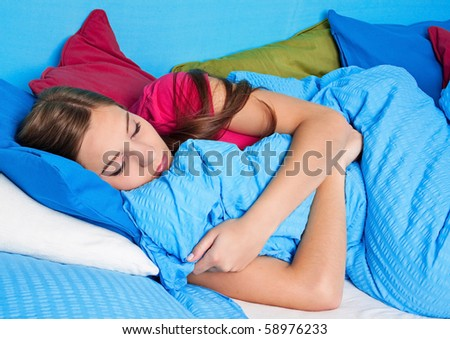 young girl sleeping in her bed - stock photo