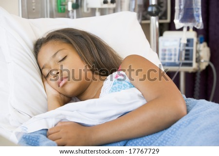 Young Girl Sleeping In Hospital Bed - stock photo