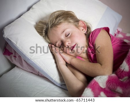 Young Girl sleeps in her bed