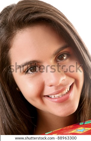 Young girl smiling and looking at the camera, face close up