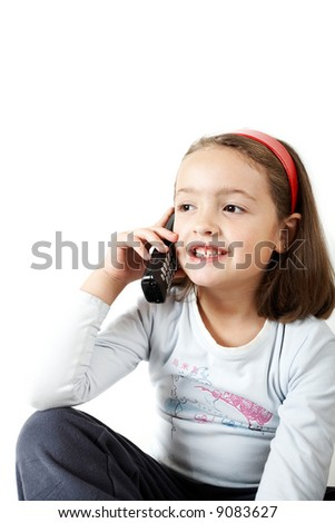 Young girl smiling and talking by phone