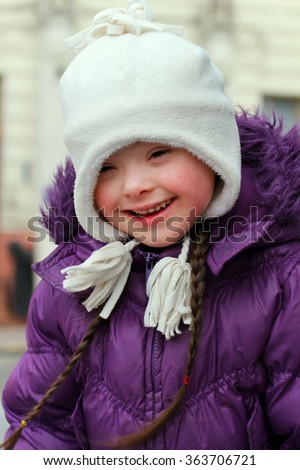 Young girl smiling in the winter - stock photo