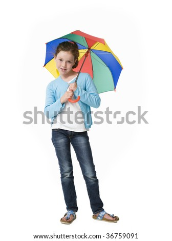 Young girl smiling to camera from under a colorful umbrella - stock photo