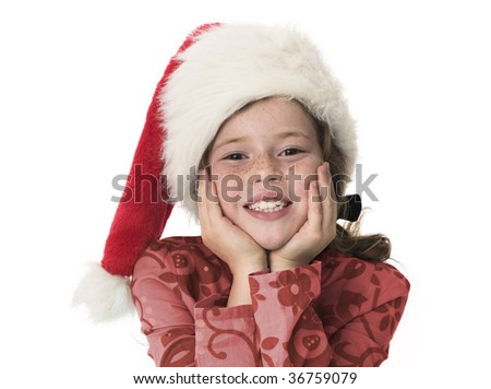 Young girl smiling to camera wearing christmas hat - stock photo